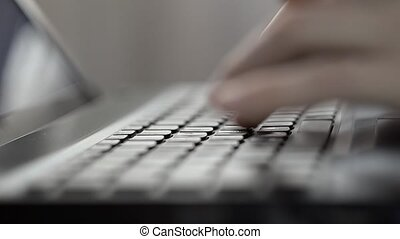 Womans Hands Typing On A Laptop Keyboard Indoor