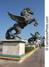Pegasus Palace - Two statues stand over a public plaza in...