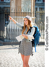 happy attractive exchange student girl visiting Madrid city...