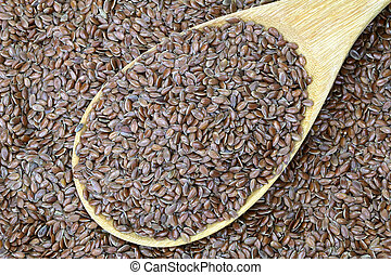 A wooden spoon of Linseed, Flaxseed - A wooden spoon full of...