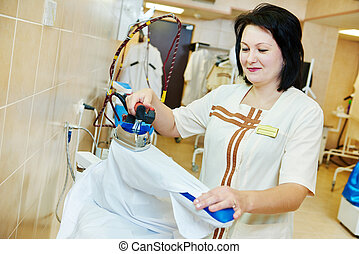ironing service - cleaning services Woman with iron working...