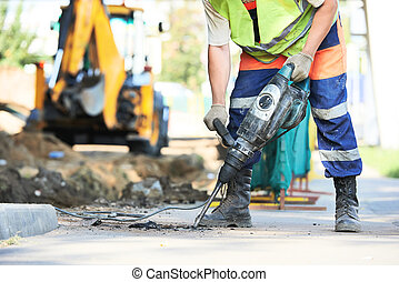 road construction worker with perforator - Builder worker...