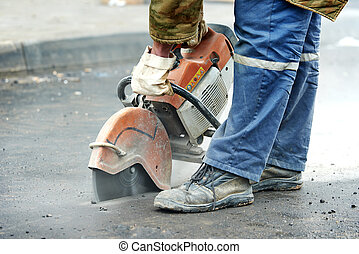 construction worker with cut-off machine - Builder worker...