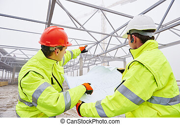 Construction builder workers - male engineers construction...