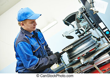 car wheel tyre fitting or replacement - Auto repairman...