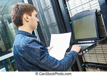 service engineer in server room - network engineer working...