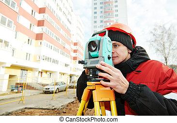 surveyor works with theodolite - One surveyor worker working...