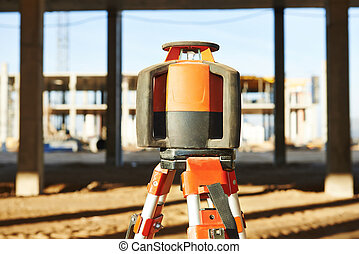 laser levelling equipment at construction site - Rotating...