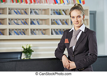 Hotel manager on reception - Happy female manager worker...