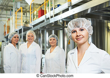 pharmaceutical factory workers - portrait of female...