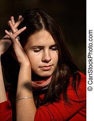 Thoughtful brunette girl