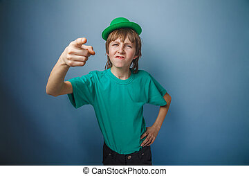 European-looking boy of ten years discontent is pointing at...
