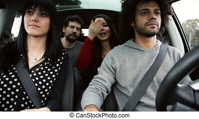 friends driving car happy - four happy people having fun in...
