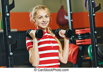 woman with barbells in fitness gym