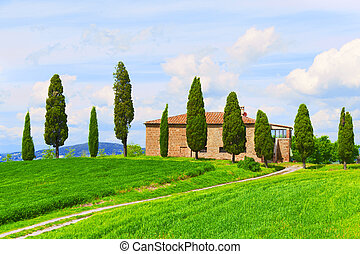 Beautiful rural landscape with the stone house, cypresses...
