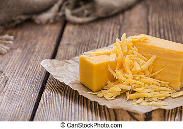 Grated Cheddar Cheese on rustic wooden background