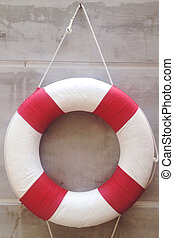 life preserver on a wall