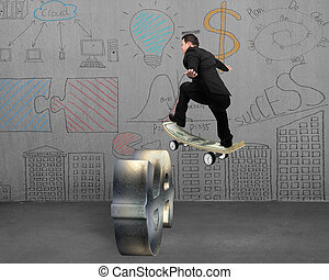 Businessman skating on money skateboard across metal dollar...