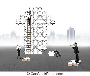 Businessman commanding workers to build arrow jigsaw puzzle...