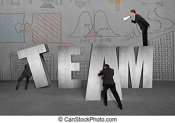 Businessman commanding employees to move TEAM word together...