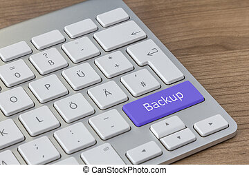 Backup on modern Keyboard - Backup written on a large blue...