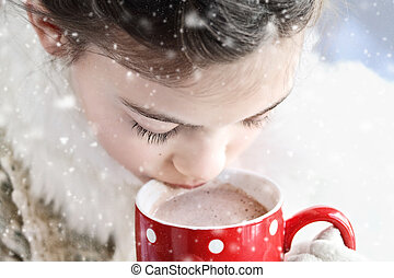 Young girl drinking hot chocolate outdoor - Young girl...