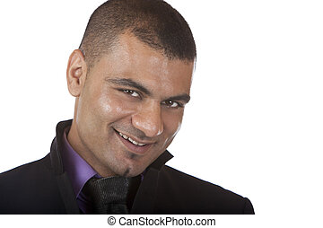 Young Business man smiles in camera