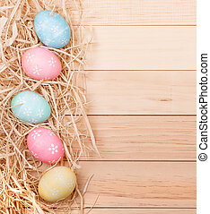 Easter Egg Border - Vertical Easter egg border on a wood...