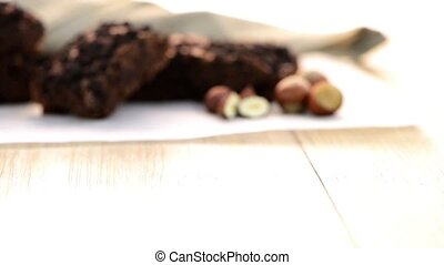Tasty chocolate brownies on a wooden table