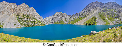 Kyrgyzstan - Scenic panorama of turquoise lake in...