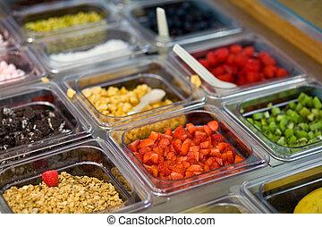 selection of toppings - A selection of toppings in an ice...