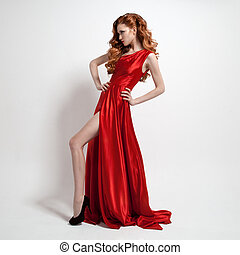 Young beautiful woman in red dress. White background.