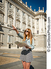 happy beautiful exchange student girl visiting Madrid city...