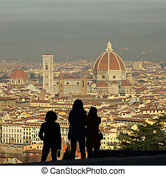 profiles of tourists admiring fantastic view of Florence...