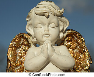 praying little angel figure with golden wings isolated on...