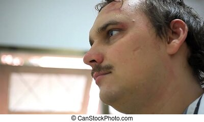 Smiling young moustached man in scars on face. HD. 1920x1080...