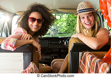 Happy friends on a road trip on a summers day