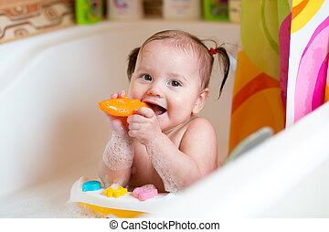 toddler boy taking a bath - cute toddler kid girl taking a...
