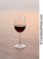 Glass of wine at sunset on the sea