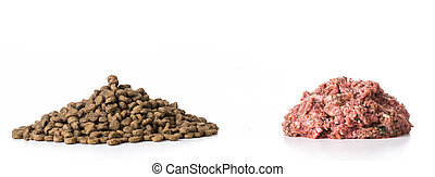 kibble or raw - kibble and raw pile of food isolated on...