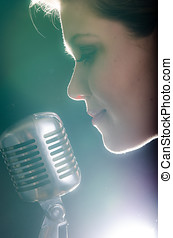 Closeup of beautiful woman with microphone