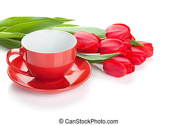 Fresh red tulips with coffee cup Isolated on white...