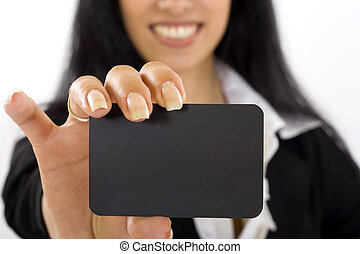 young woman showing her business card, focus on fingers and...