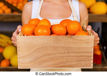 The freshest tangerines. Cropped image of young woman in...