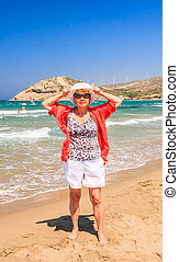 Woman on the beach of the isthmus Prasonisi. Rhodes Island....