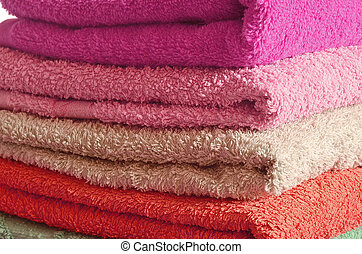 Stack of pink and purple towels