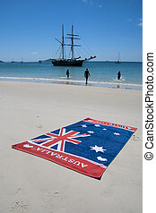 Australia Flag and a stunning view of Whitehaven Beach in...
