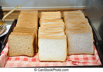 Many bread type on red napery