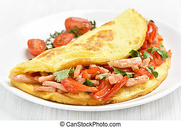 Omelette with ham and vegetables on white plate, close up...