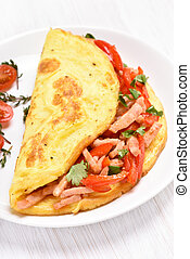 Scrambled eggs with bacon and vegetables